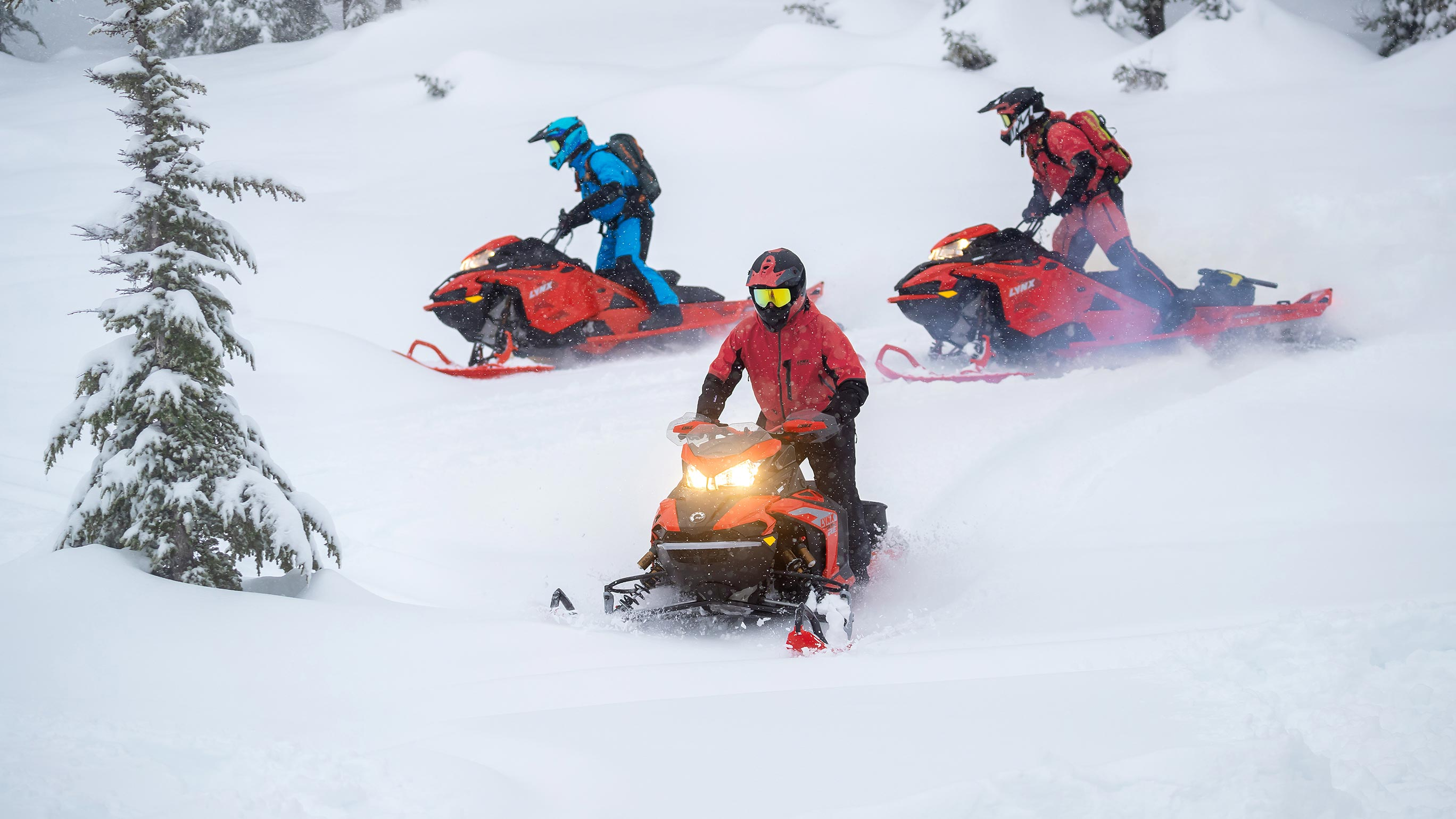 Three Lynx snowmobiles riding in different directions