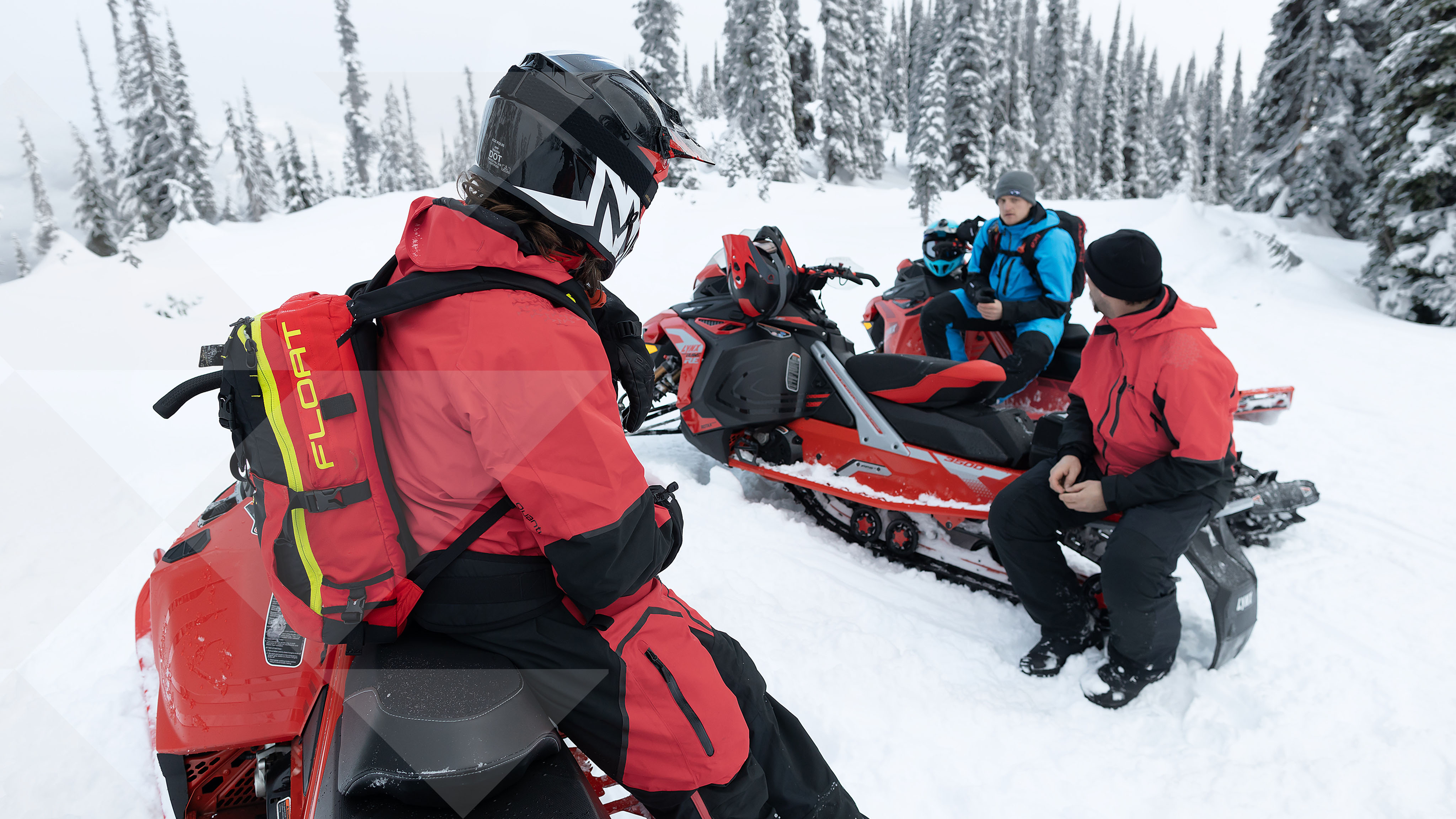 3 Riders talking during a snowmobile backcountry ride