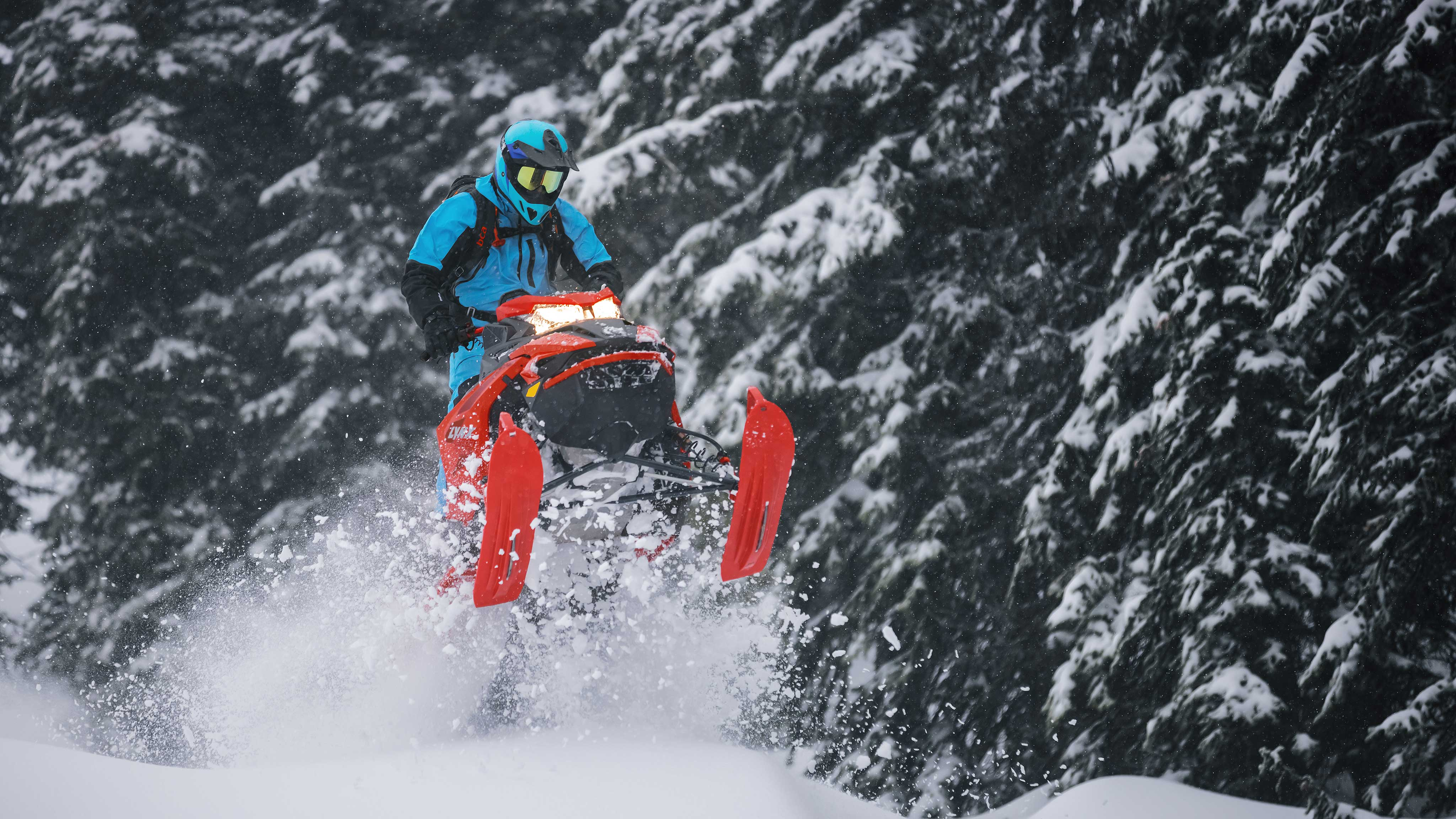 Man jumping with his 2022 Lynx BoonDocker in Deep-Snow