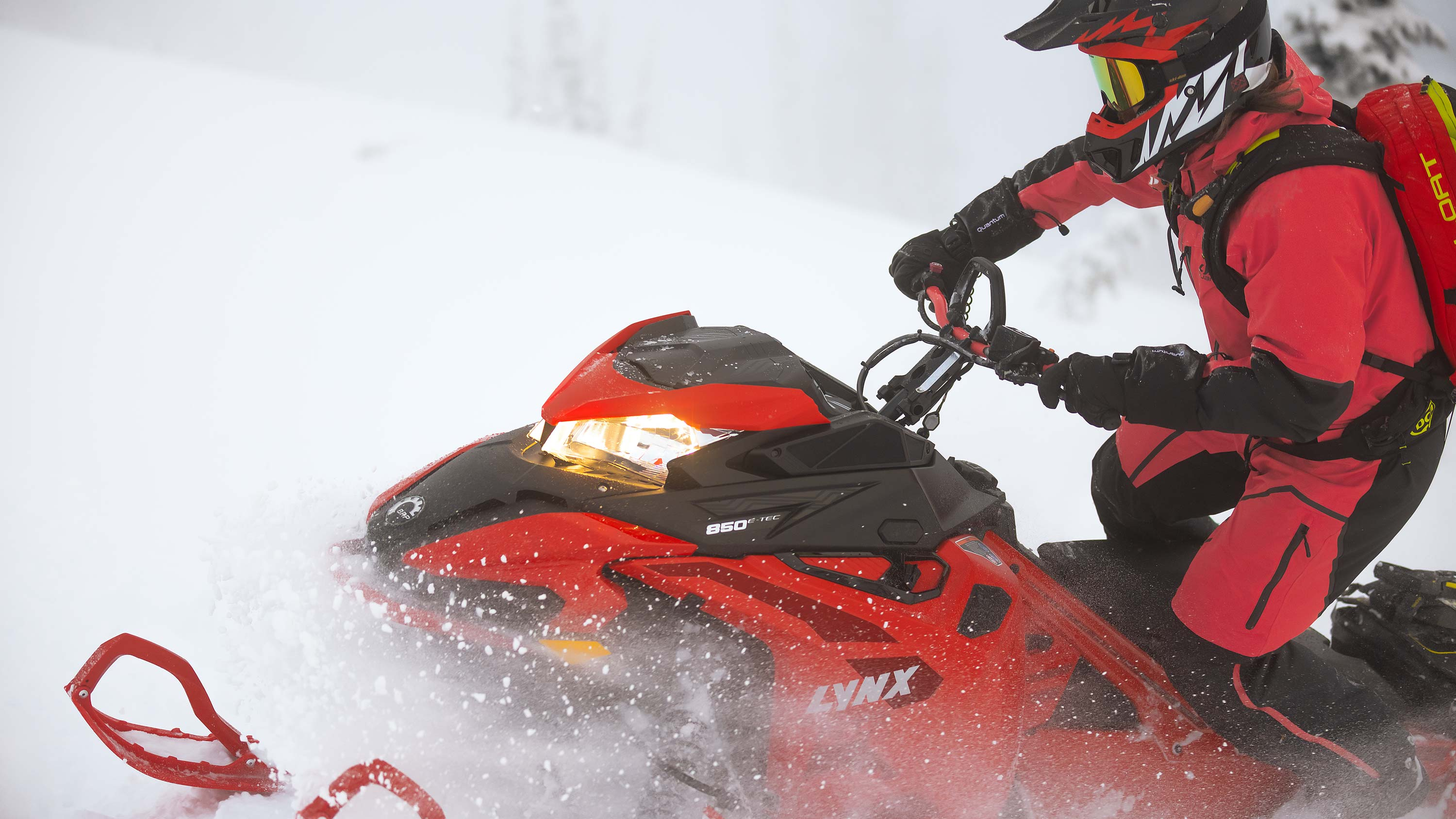 Closeup of Lynx BoonDocker snowmobile rider on terrain