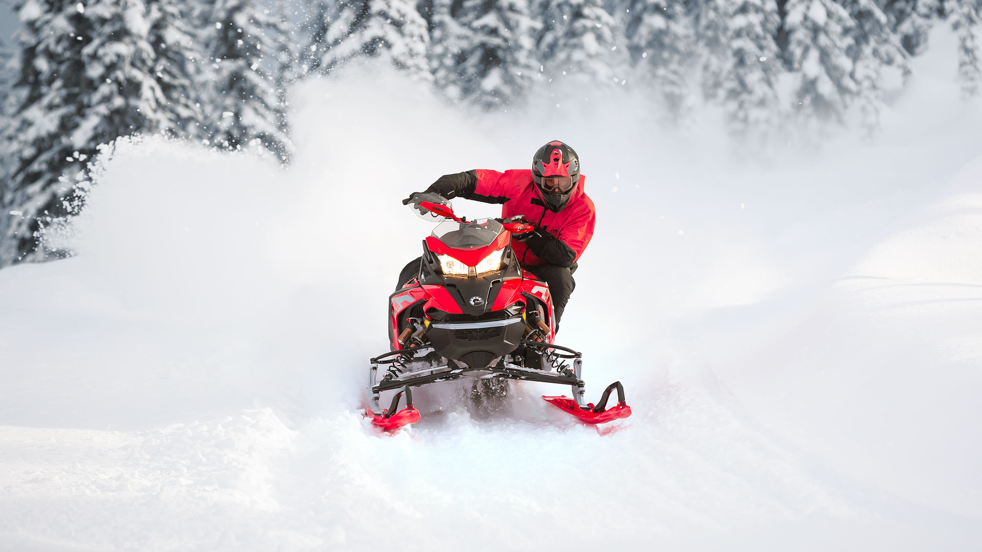 Lynx Rave snowmobile riding on trail