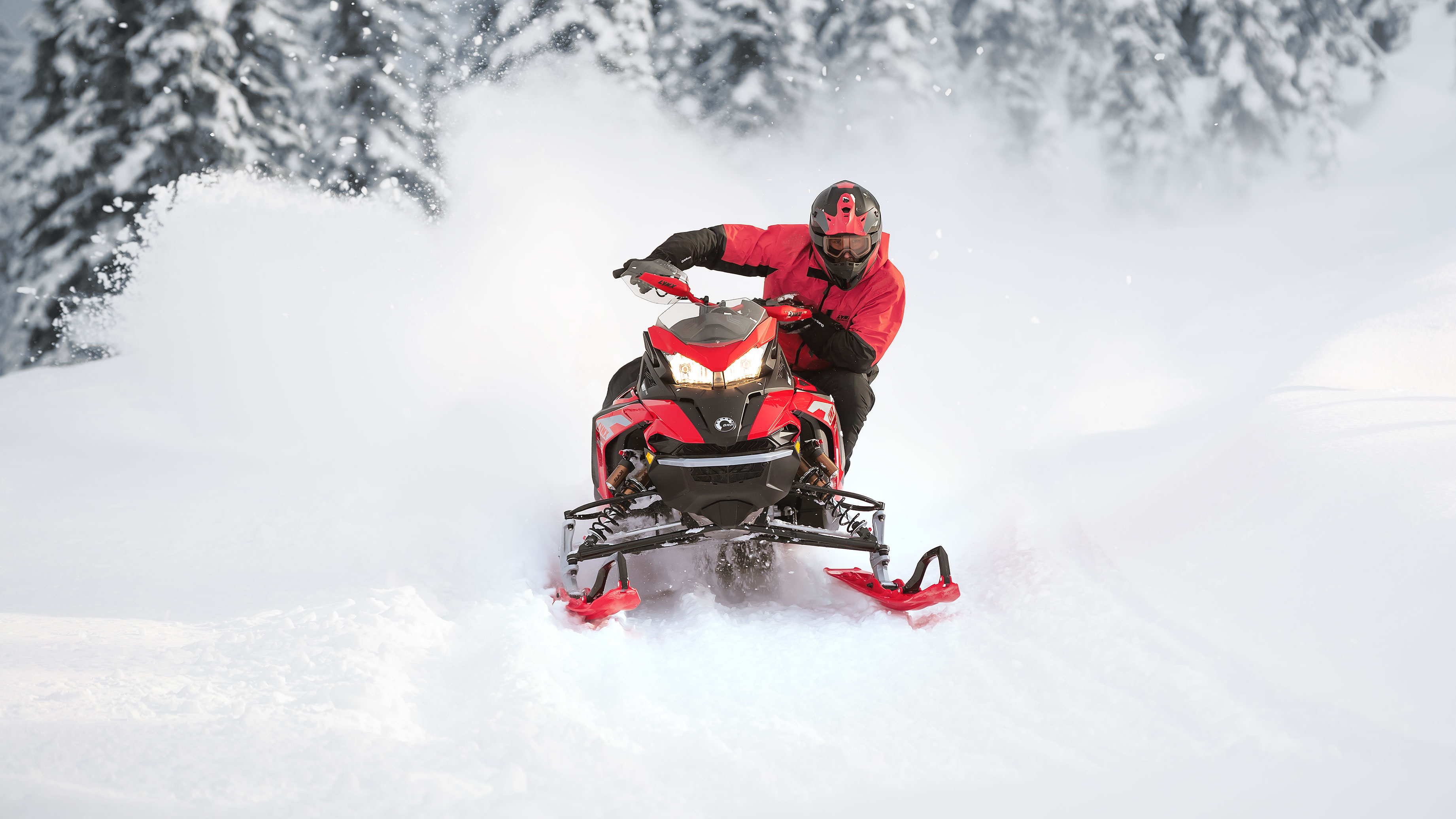 Man snowmobiling in candle with his 2022 Lynx Rave