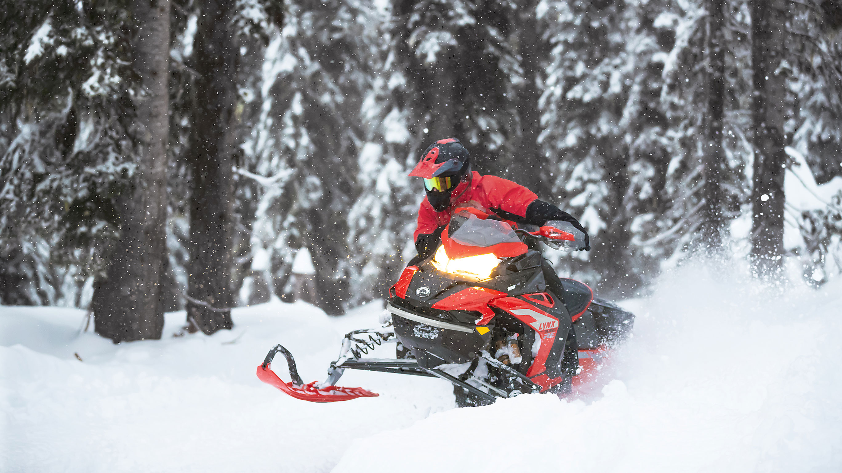 Lynx Rave RE snowmobile curving on a trail