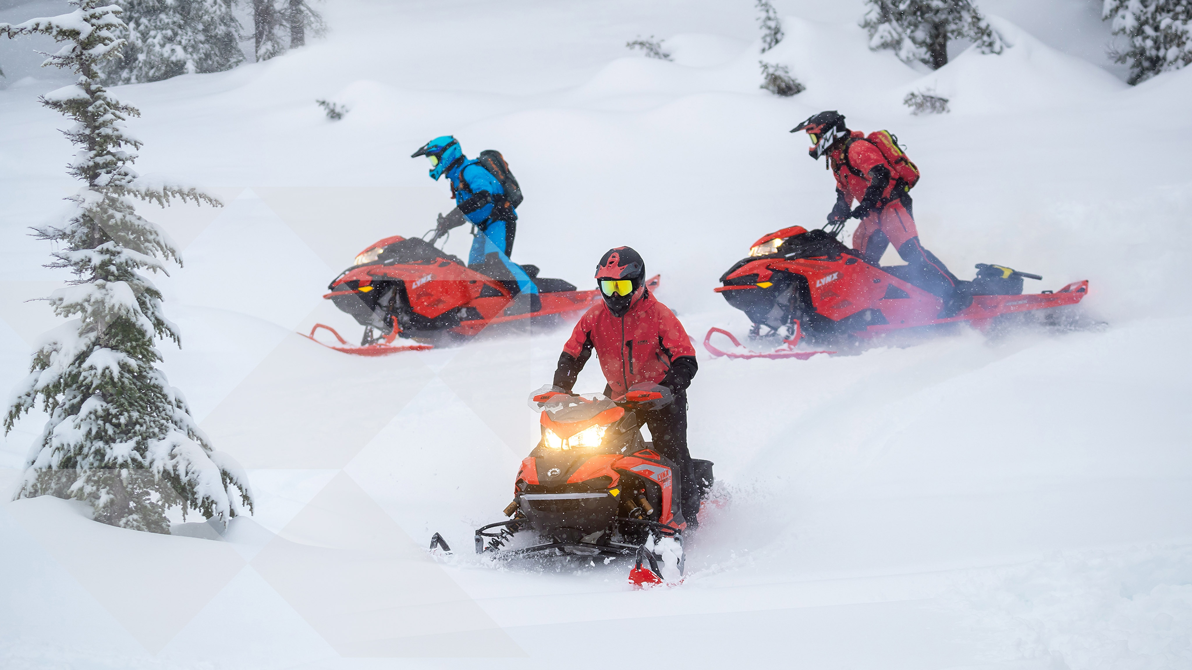 3 mens riding Lynx Snowmobiles