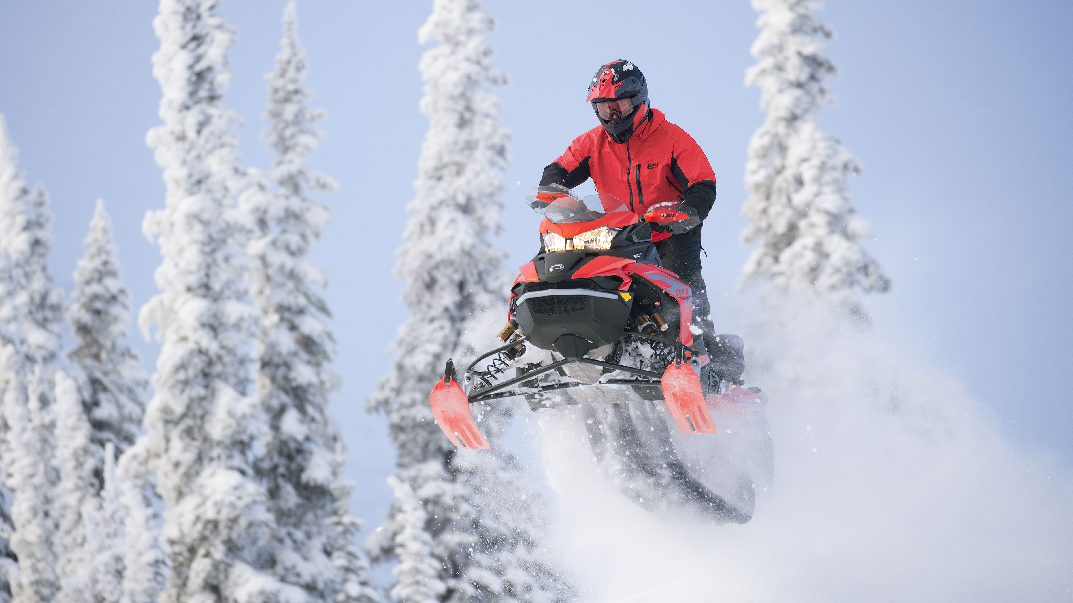 Lynx Rave RE snowmobile riding on bumpy trail