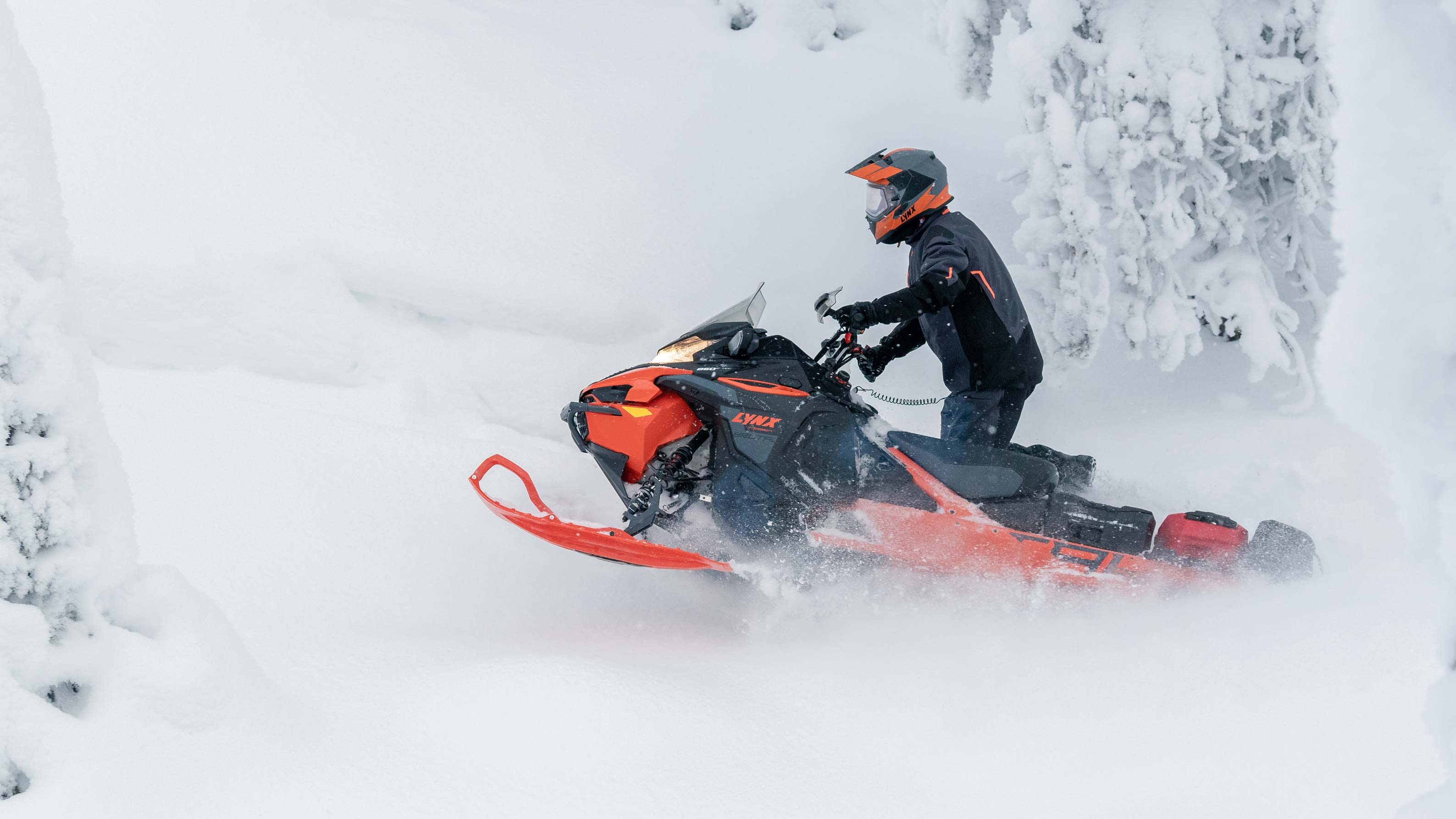 LinQ accessorized Lynx Xterrain Brutal snowmobile riding in deep snow