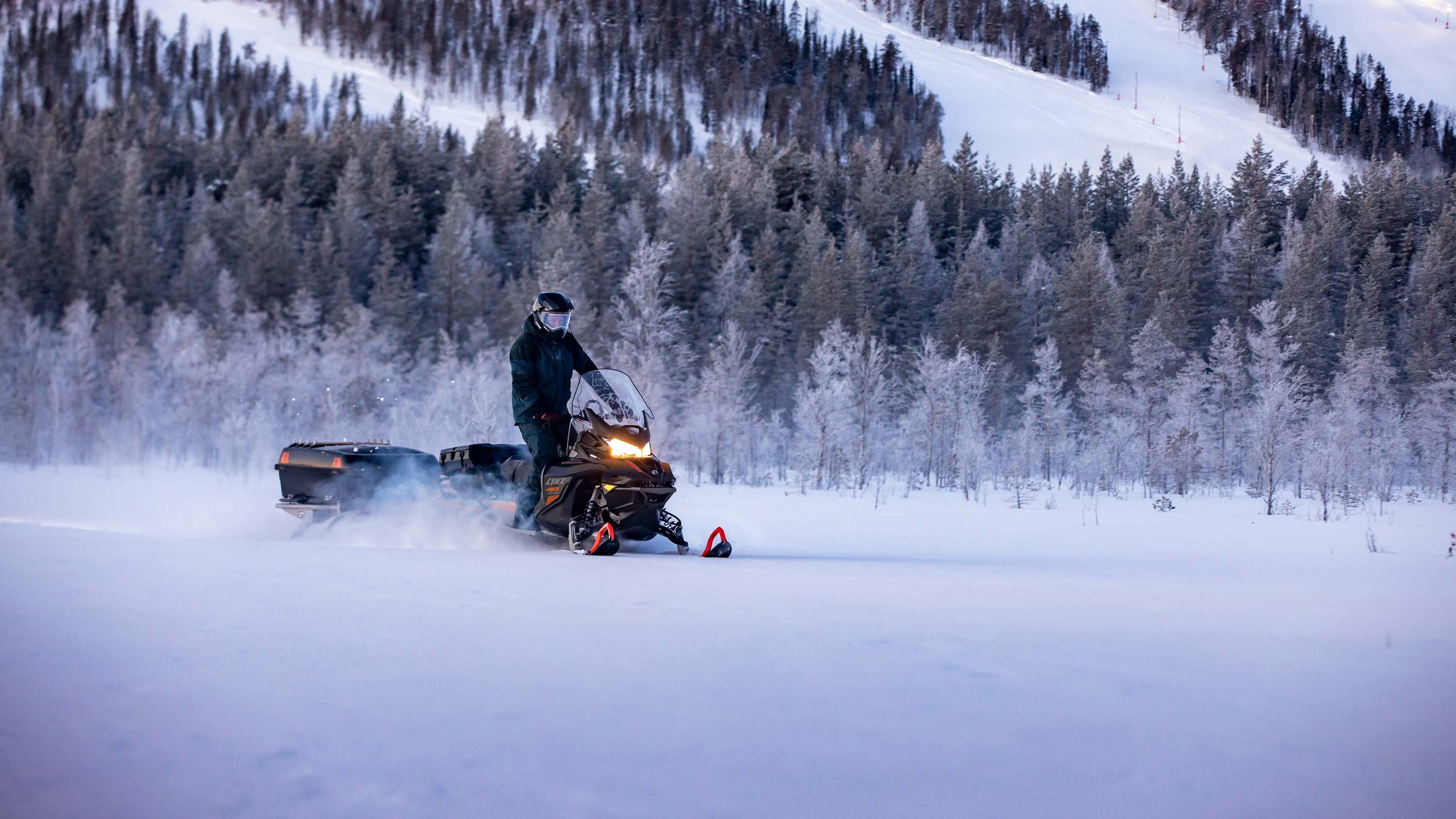 Lynx 49 Ranger snowmobile riding with LinQ Carrier sledge