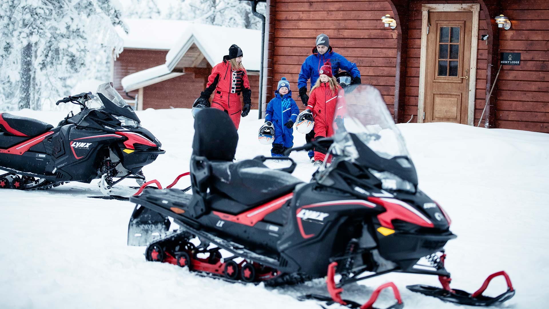 Family going riding with Lynx Adventure snowmobiles