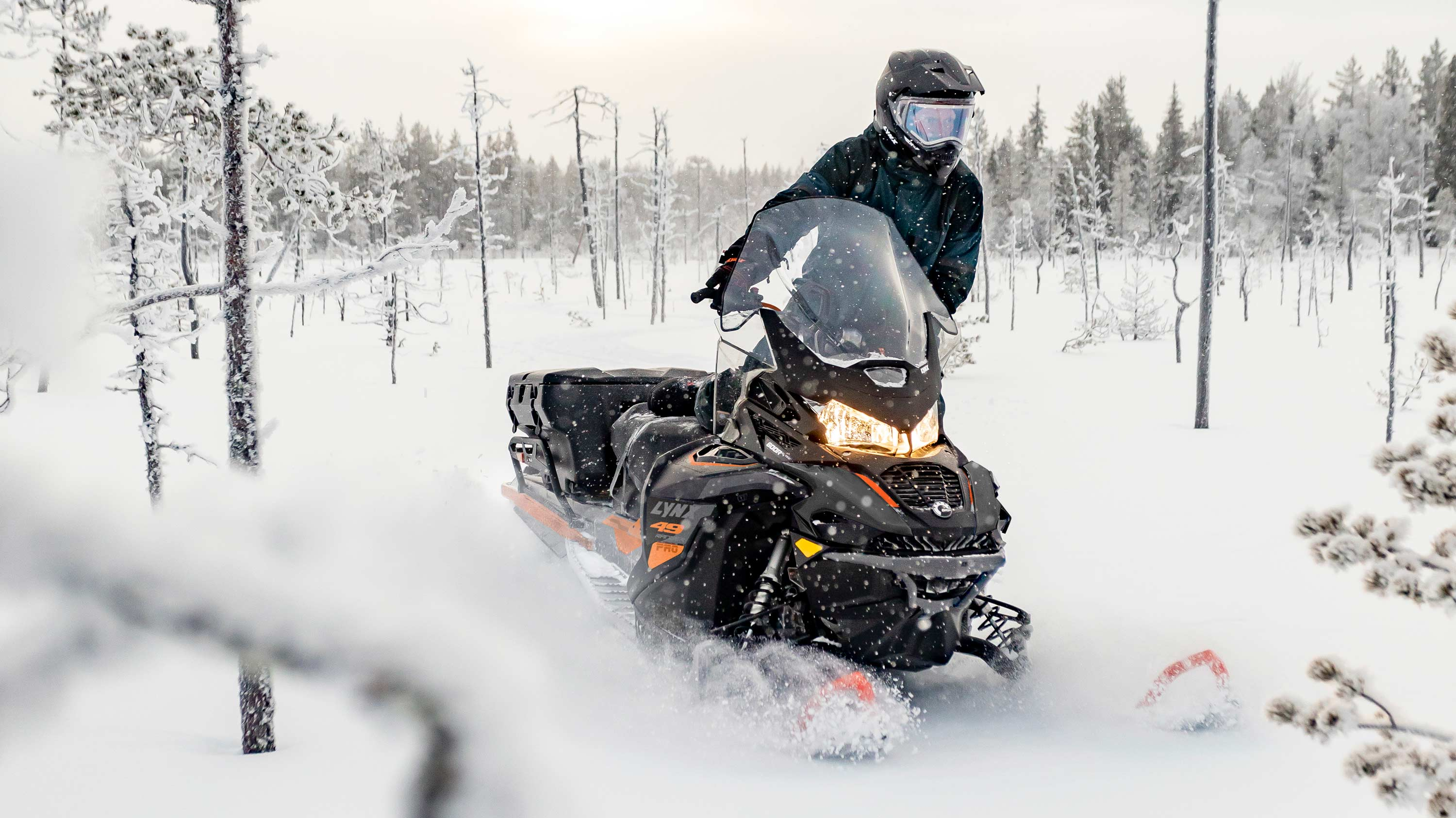 Lynx 49 Ranger snowmobile riding in challenging terrains