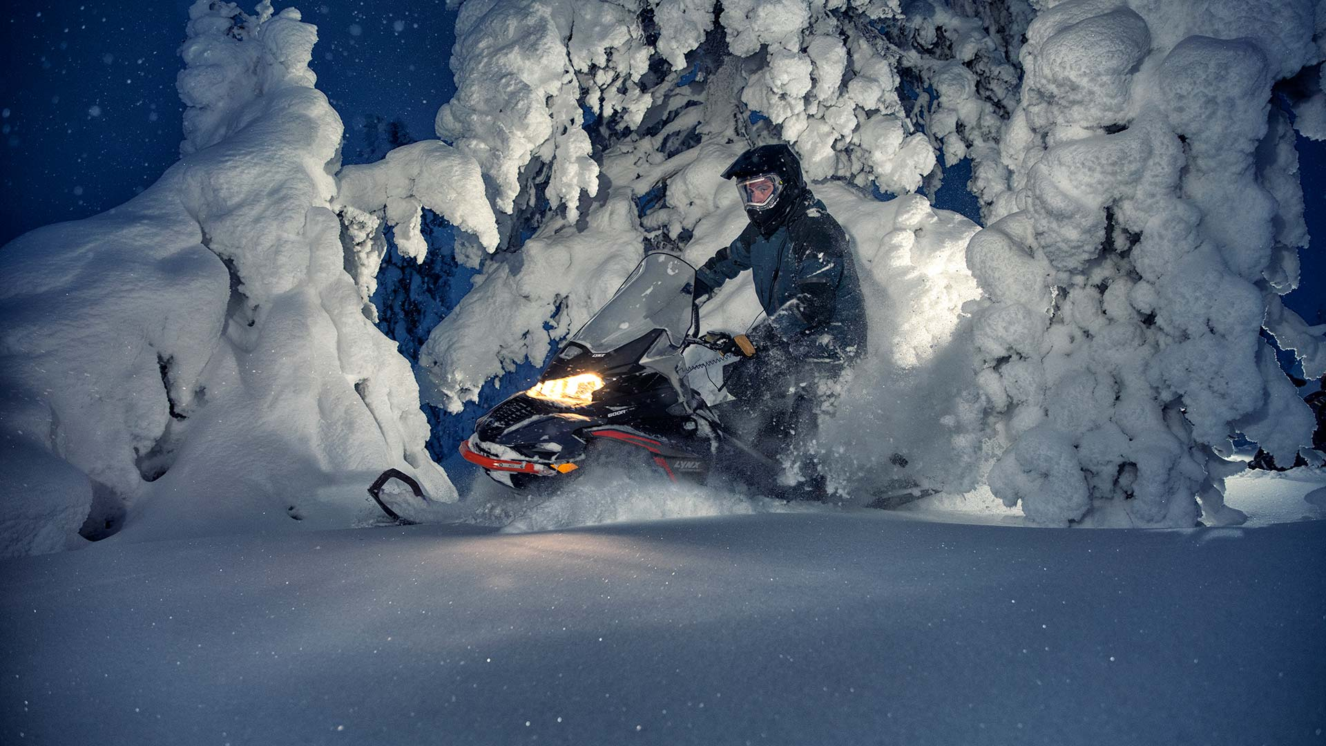 Lynx Commander snowmobile riding in Arctic snowy forest