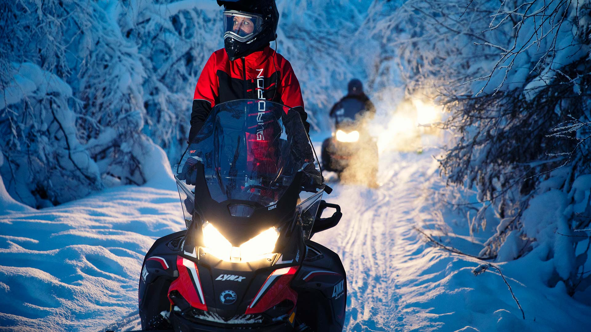 Lynx Adventure snowmobile riding in snowy forest