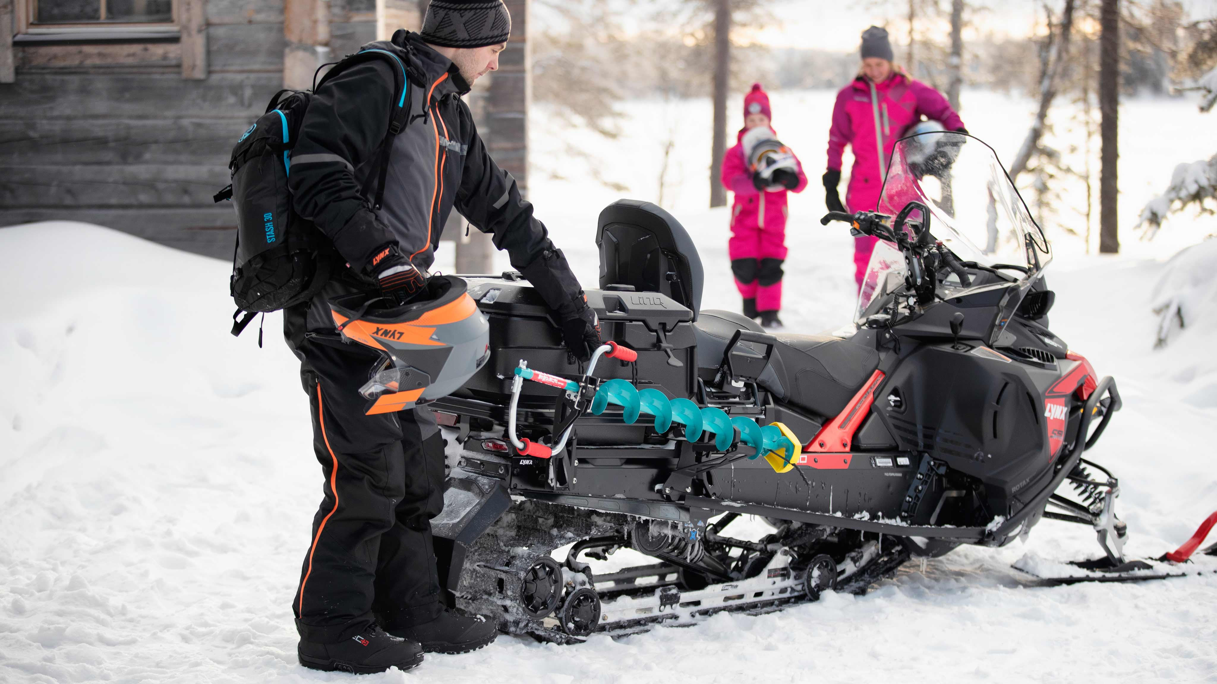 Family preparing to ride a Lynx 59 Ranger snowmobile